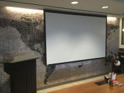 podium and projector screen for presentations