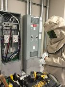 Electrical box with technician in protective gear