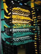 green and yellow wiring in server rack